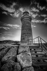 Drawn to the Light (Arnie Sacknooson) Tags: bw lighthouse clouds port spain rocks mediterranean mallorca 1740mm andratx nofilter balearics spanishlighthouse eos5dmk1 arniesacknooson