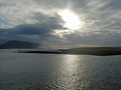 Stromness Lighthouse and the sun (Dunnock_D) Tags: uk sea sky cloud sunlight grey scotland orkney cloudy unitedkingdom harbour stromness