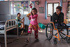 Nirmala practices walking with her new leg as Khembro and Ramesh watch at the National Disabled Fund. (Handicap International UK) Tags: nepal handicapinternational ngo prosthesis physiotherapy rehabilitation nepalearthquake