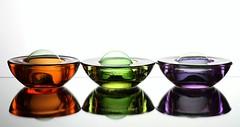 Trio (Karen_Chappell) Tags: stilllife orange white 3 reflection green glass three purple multicoloured bubble colourful candleholder