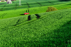 Foreign object (dlorenz69) Tags: auto red green rot field car landscape spring hessen object feld spuren traces artificial grn agriculture foreign sonnig landschaft taunus frhling acker knstlich kulturlandschaft heiter