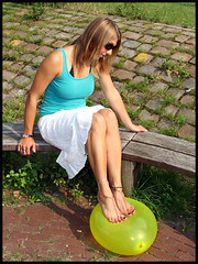 Paloma having fun with a balloon (sunnystreets) Tags: feet female balloons outdoors foot legs balloon pop jewellery rings crushing barefoot pedicure stomping popping anklets squishing