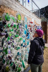 Amanda admires a colourful wall exhibit in Bisbee, AZ.