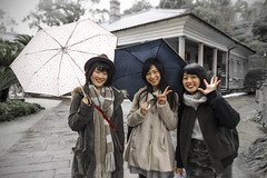Nagasaki girls (Sacule) Tags: old travel viaje girls red portrait people blackandwhite white house cute beautiful rain japan umbrella canon asian funny asia retrato young posing sigma east traveller zen backpack western nippon prefecture japon nagasaki decolored asianbeauty glovergarden 600d  sigma1770mm kyushuisland