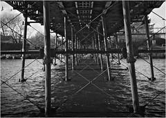Southport pier bridge (Pitheadgear) Tags: bridge blackandwhite bw water monochrome grid mono columns lakes bridges engineering ironwork southport lattice girders grids merseyside sefton boatinglakes