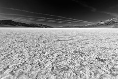 """Scale"" (helmet13) Tags: d800e raw deathvalleynationalpark badwaterbasin saltdesert landscape people width space silence mountains 86mbelowsealevel california usa bw redfilter salt aoi heartaward peaceaward platinumpeaceaward 100faves world100f simplicity"