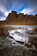 Scary face on the snow (Daniele Bisognin) Tags: blue winter sunset sky italy orange lake snow mountains alps ice water colors yellow clouds peak dolomites