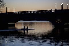 Pairs (manyamoon) Tags: bridge sunset reflection silhouette boston river massachusetts harvard charlesriver newengland pairs rowing cambridgema harvardfootbridge