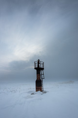 Few seconds before the snowstorm (alexander.alechits) Tags: sea snow ice nature spring snowstorm shore beacon canonef1740mmf4lusm sakhalin       seaofokhotsk  sakhalinisland  canoneos5dmarkiii alexanderalechits