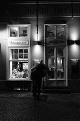 Looking at the menu (MaxDeVa) Tags: leica blackandwhite bw night 35mm lights restaurant belgium brugge bruges luci f2 monochrom asph notte yellowfilter belgio summicronm