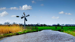 Waterland - ditches, mills and grass (Boudewijn Vermeulen) Tags: blue green water grass clouds landscape bomen groen blauw skies meadows wolken gras landschap waterland luchten sloten ditches publ
