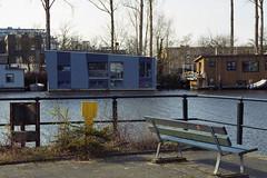 Watery corner (Arne Kuilman) Tags: film water amsterdam bench living nikon kodak bank scan nikonf3 expiredfilm bankje 28105mm woonboot