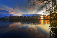 Colorful sunset (jan.arnds) Tags: blue trees sunset sea orange sun lake reflection nature water colors clouds mirror spring pond exposure outdoor reflect short teich goldenhour janarnds