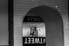 #TWEET Upsidedown (ROYEARS) Tags: street city people paris art canon underground subway eos 50mm waiting metro photos pics april wait m11 texting tweet t3i aprilfool tlgraphe 600d ligne11 twitter 1stapril 1eravril