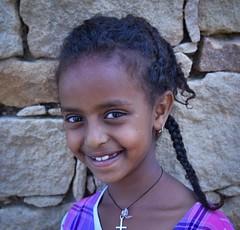 Adigrat Girl, Ethiopia (Rod Waddington) Tags: portrait people girl smile female child cross outdoor christian ethiopia ethnic pigtail ethiopian etiopia ethiopie tigray adigrat