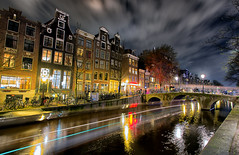 Red light district (Pat Charles) Tags: city longexposure travel bridge urban holland tourism netherlands amsterdam architecture night river boat canal nikon europe 1001nights exploration 1001nightsmagiccity