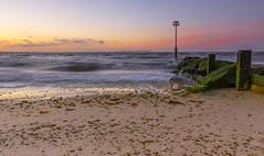Cold (nicklucas2) Tags: sea seascape beach rock sand isleofwight solent groyne mudeford avonbeach