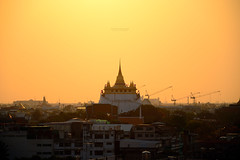 Golden Mountain (Rotationism) Tags: travel sunset red sky sculpture mountain art history architecture landscape thailand outside religious temple gold golden pagoda ancient worship asia cityscape bangkok buddha buddhist traditional religion culture royal grand landmark fair palace tourist mount monastery thai historical spirituality southeast cloth oriental lightening spiritual wat ornamental saket siam cultural ethnicity