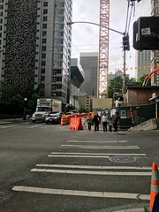Waiting to cross the street amid lots of downtown construction (Seattle Department of Transportation) Tags: seattle family waiting closed downtown crossing crane sidewalk transportation pedestrians crosswalk walkers sdot