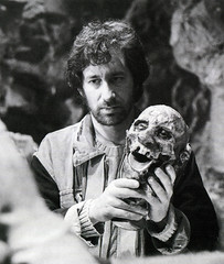 Steven Spielberg holding a head in the Temple of Doom (Tom Simpson) Tags: film vintage skull behindthescenes indianajones severedhead shrunkenhead stevenspielberg templeofdoom thetempleofdoom