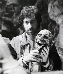 Steven Spielberg holding a head in the Temple of Doom (Tom Simpson) Tags: film vintage skull behindthescenes indianajones severedhead shrunkenhead stevenspielberg templeofdoom thetempleofdoom