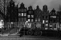 Vintage Amsterdam (McQuaide Photography) Tags: street old city longexposure nightphotography winter light shadow urban blackandwhite bw holland netherlands monochrome dutch amsterdam bike bicycle architecture night zeiss photoshop vintage outside mono licht blackwhite lowlight streetlight europe nacht outdoor sony traditional tripod capital nederland wideangle row fullframe alpha oud stad authentic fiets manfrotto noordholland gracht lightroom brouwersgracht straat canalhouse wideanglelens capitalcity 1635mm northholland a7ii grachtenpand groothoek variotessar melkmeisjesbrug mirrorless sonyzeiss mcquaidephotography ilce7m2