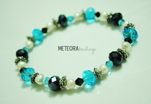 Bracelet - black, blue and pearl-color beads, with silver seperators
