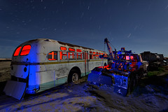 bus and tow. mojave desert, ca. 2016. (eyetwist) Tags: california old longexposure blue light red lightpainting west bus dusty night truck dark painting photography star nikon gm long exposure glow desert angle decay details transport wide ruin trails wideangle fullmoon moonlit faded chrome american edge highdesert mojave moonlight weathered junkyard nikkor retired derelict tow nocturne wrecked trucking patina startrails mojavedesert mudflapgirl mudflap mudflaps eyetwist npy d7000 capturenx2 eyetwistkevinballuff hollywoodrentals nikond7000 1024mmf3545g