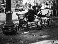 Sharing A Mobile Moment (TMimages PDX) Tags: road street city people urban blackandwhite monochrome buildings portland geotagged photography photo image streetphotography streetscene sidewalk photograph pedestrians pacificnorthwest avenue vignette fineartphotography phoneography