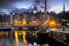 """a breeze shivers the reflections of lights as a summer day ends over the Vieux Bassin, Honfleur, Normandy, France (grumpybaldprof) Tags: old summer vacation sky holiday signs france colour reflection monument water stone architecture clouds port marina buildings reflections boats lights evening town dock ancient bars sailing harbour ships sails illumination restaurants july historic mooring normandie honfleur yachts picturesque masts normandy quai halftimbered collombage quarantaine """"quaistecatherine"""" """"lalieutenance"""" """"oldharbour"""" """"vieuxbassin"""" """"quaiquarantaine """"stecatherine"""""""