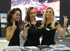Porsche girls (Dag Kirin) Tags: auto show girls hair curly zagreb porsche blonde brunette ebony 2016