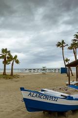 Spain - Malaga - Fuengirola (Marcial Bernabeu) Tags: sky espaa cloud beach palms boat andaluca spain barca cloudy playa palmeras andalucia palm cielo nubes nublado andalusia palmera malaga cluds nube fuengirola mlaga bernabeu marcial bernabu nuboso