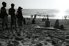 Kuta beach (onbalcony) Tags: sunset bw bali film beach silhouette surfing row kuta   ricohgr1s fujifilmrca100
