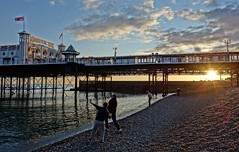 """skimming stones"" (Westhamwolf) Tags: sunset sea england beach pier brighton stones skimming"