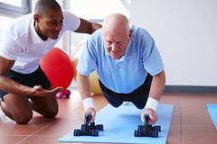 Senior Doing Push-Ups with His Trainer (garibalde.neto) Tags: people man black male men senior smiling horizontal happy coach 60s adult exercise bald diversity lifestyle health elderly motivation effort strength pushups workout fitness youngadult gym twopeople youngman trainer 20s caucasian multiracial wellbeing healthclub encouragement seniorman activewear exerciseequipment agecontrast healthylifestyle bodyconscious activesenior expressingpositivity