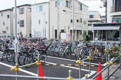 Bicycle park, with guard (tiramasuface) Tags: japan tokyo saitamaken saitamashi