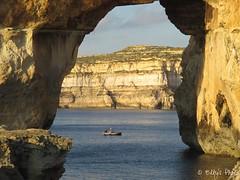 Pescatori (Elly212) Tags: blue cliff seascape rock stone landscape see bay boat mar mediterraneo barca mare arch fishermen hole blu paisaje malta marino paesaggio rocas gozo scogliera arrecife baha baia pescatori