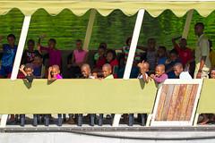 Children on a fieldtrip in Chobe National Park (ScottMcQueen) Tags: africa school children locals smiles fieldtrip botswana waving schooltrip travelphotography yolo guidedtour chobenationalpark africanchildren gadventures