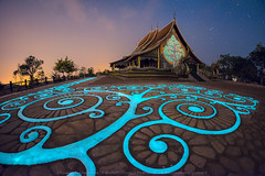 Aglow in the Night (KRW_GNS) Tags: city travel light sky reflection art history tourism church beautiful skyline architecture night dark asian thailand religious temple dawn amazing twilight ancient asia cityscape view place dusk background buddhist traditional famous religion culture illumination buddhism landmark illuminated thai southeast wat vacations destinations ubon ubonratchathani ratchathani