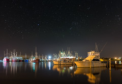 Viking Village Night (Jason Gambone) Tags: ocedan vikingvillage wallart jasongambone sunset bay stars newjersey boats canon canon6d reflection barnegatlight night nightsky fishingpier dusk photographer fishingboats fishing nj fishingdock sky framedart jasongambonecom photography atlanticocean barnegat