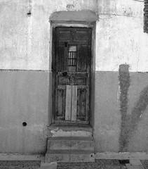 Puerta / Door (Rafa Gallegos) Tags: madrid door old blackandwhite bw espaa byn blancoynegro vintage spain puerta antiguo navalcarnero