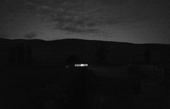 and those in the darkness.... (ChrisRSouthland (back in Athens - at last)) Tags: red newzealand sky blackandwhite monochrome night clouds landscape hill illumination illuminated lastlight elmarit28mmf28 mmonochrom