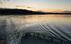 Seattle bound. (Brendinni) Tags: sunset color tree water ferry clouds canon washington shoreline pugetsound ripples railing treeline washingtonstateferry