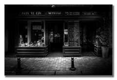 Born to be a livre (Descended from Ding the Devil) Tags: windows blackandwhite bw france monochrome shop pavement fullframe bookshop oldtown carcassonne bollards languedocroussillon midipyrenees mirrorless photoborder sonya7mkii