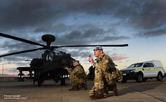 MPGS Patrol guarding Apache Helicopters (Defence Images) Tags: uk man male clouds radio sunrise army moving belt clothing apache gun personal action aircraft military attack crest equipment helicopter camouflage badge pouch weapon vehicle soldiers british beret kneeling landrover defense a2 defence communications role mtp firearm prr headwear personnel sa80 aiming webbing assaultrifle combats 556mm smallarms identifiable plce middlewallop patrolvehicle mpgs adjutantgeneralscorps multiterrainpattern personalloadcarryingequipment ah1d themilitaryprovostguardservice