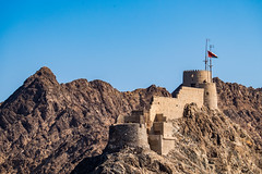 Muttrah fort - Oman (Lars Helge) Tags: old sky mountain hot rock stone fuji fort stones flag middleeast sunny x mat arabia arabian oman portuguese fujinon muttrah 1580 mutrah xseries 2015 sixteenthcentury sultanateofoman omani sultanate 18135    xt1   fujixt1 fujinonxf18135mmf3556rlmoiswr mutrrahfort