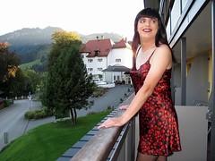 Welcoming the sun (Paula Satijn) Tags: red black sexy girl hearts outside austria shiny dress balcony silk tgirl satin gurl nightdress chemise nightie