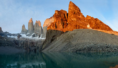 torres del paine (Luke Sergent) Tags: chile travel patagonia mountain lake reflection tower tourism southamerica nature argentina del america sunrise spectacular landscape dawn scenery south awesome famous pillar dramatic peak landmark national andes destination torresdelpaine mirador rugged daybreak alpenglow torres paine