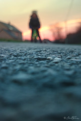 Promenade (Ben Heine) Tags: road street sunset house sol bike silhouette sunrise drive evening stand colorful village child play floor pavement walk horizon run route promenade rue enfant lead bitume macadam debout goudron chausse asphalte smartphonephoto pavage benheine