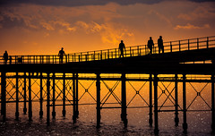 Pier Fantasy (Explored Apr 14, 2016) (creativegaz) Tags: ocean light sunset shadow sea sky people orange seascape colour water lines silhouette clouds contrast sunrise wow wonderful walking person pier seaside nikon moody shadows walk perspective shapes silhouettes silo epic tranquil seaview 810 creativemindsphotography